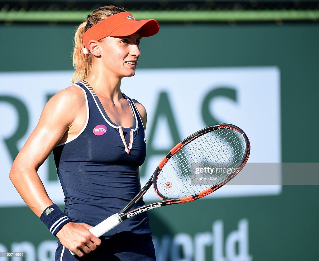 <a gi-track='captionPersonalityLinkClicked' href=/galleries/search?phrase=Lesia+Tsurenko&family=editorial&specificpeople=7654433 ng-click='$event.stopPropagation()'>Lesia Tsurenko</a> of Ukraine smiles after a point won against Mayo Hibi of Japan during qualifying of the BNP Paribas Open tennis at the Indian Wells Tennis Garden on March 9, 2015 in Indian Wells, California.