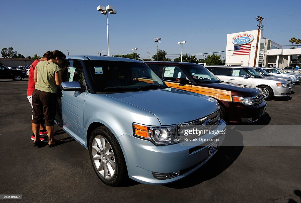 Leslee Gonzalez and her son Drew shop for a new Ford Flex taking advantage of the federal 'Cash For Clunkers' program as they attempt to trade in their 2003 Ford Expedition at Galpin Ford dealership on July 31, 2009 in Los Angeles, California. Shares of Ford Motor Co. soared Friday as investors expressed enthusiasm for increased vehicle demand under the 'cash-for-clunkers' program, which Congress is rushing to expand. Federal lawmakers are seeking an additional $2 billion to keep the popular program going after the initial $1 billion in funding ran out after a week.