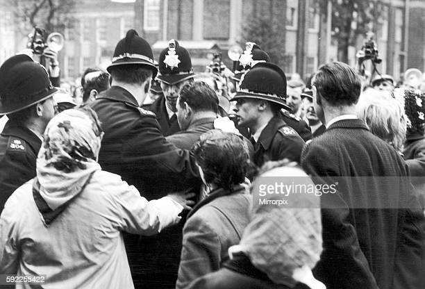 Lesley Ann Downey's Uncle is restrained by Police as accused leave Hyde Court Manchester October 1965 The Moors murders were carried out by Ian Brady...