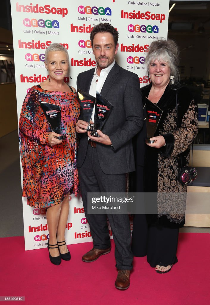 Lesley Dunlop, Dominic Power poses with he Best Bad Boy Award and Best Storyline Award and Jane Cox poses with the Outstanding Achievement Award as they attend The Inside Soap Awards at The Ministry of Sound on October 21, 2013 in London, England.