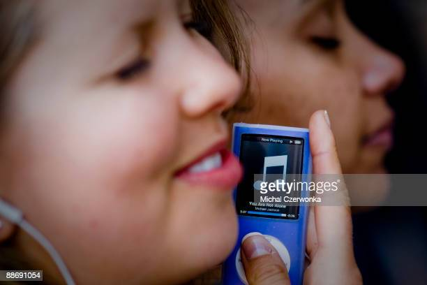 Lesley Gant and Yvonne Ordiz listen to Michael Jackson's music on an ipod outside the UCLA medical Center on June 25 2009 in Los Angeles California...