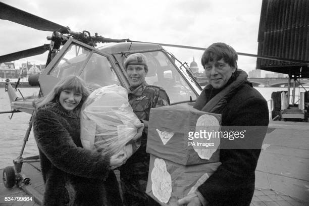 Lesley Judd and John Noakes from BBC TV's Blue Peter team receive a special delivery from Captain Mike Bell of the Third Regiment Army Air Corps...