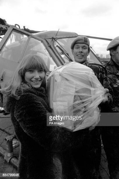 Lesley Judd from BBC TV's Blue Peter team receives a special delivery from Captain Mike Bell of the Third Regiment Army Air Corps stationed at...