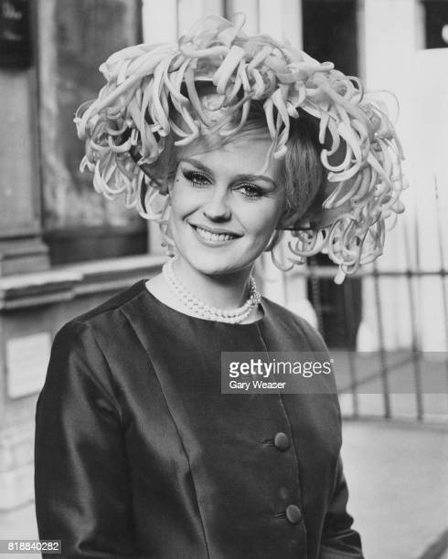 Lesley Langley winner of the 1965 Miss World contest models 'Prix de Diane' at the Christian Dior Chapeaux Spring Collection 1966 in London 30th...