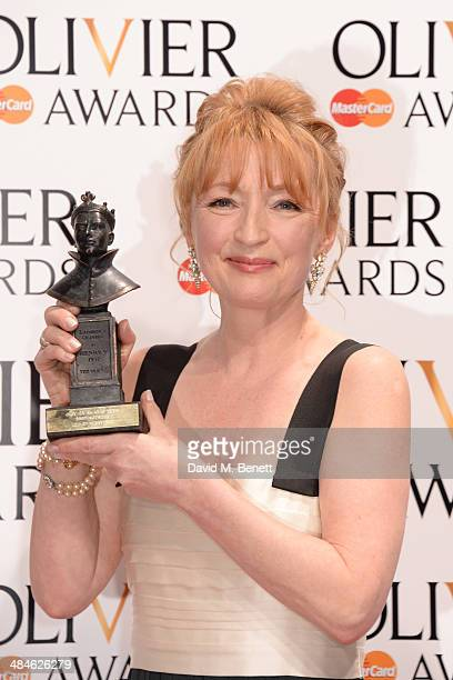 Lesley Manville winner of Best Actress for 'Ghosts' poses in the press room at the Laurence Olivier Awards at The Royal Opera House on April 13 2014...