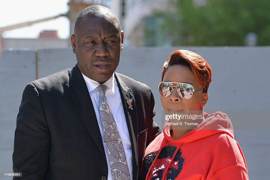 Lesley McSpadden, mother of slain 18-year old Michael Brown Jr. is comforted by the Brown Family attorney, Benjamin L. Crump after a press conference outside the St. Louis County Court Building on April 23, 2015 in Clayton, MO. to announce the civil lawsuit over the death of Michael Brown Jr. this past August in Ferguson, MO. (Photo by Michael B. Thomas/Getty Images) Local Caption: Lesley McSpadden; Benjamin L. Crump