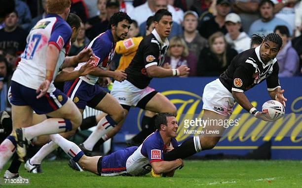 Lesley Vainikolo of New Zealand looks to off load the ball as he is tackled by Danny McGuire of Great Britain during the XXXX Test match between...