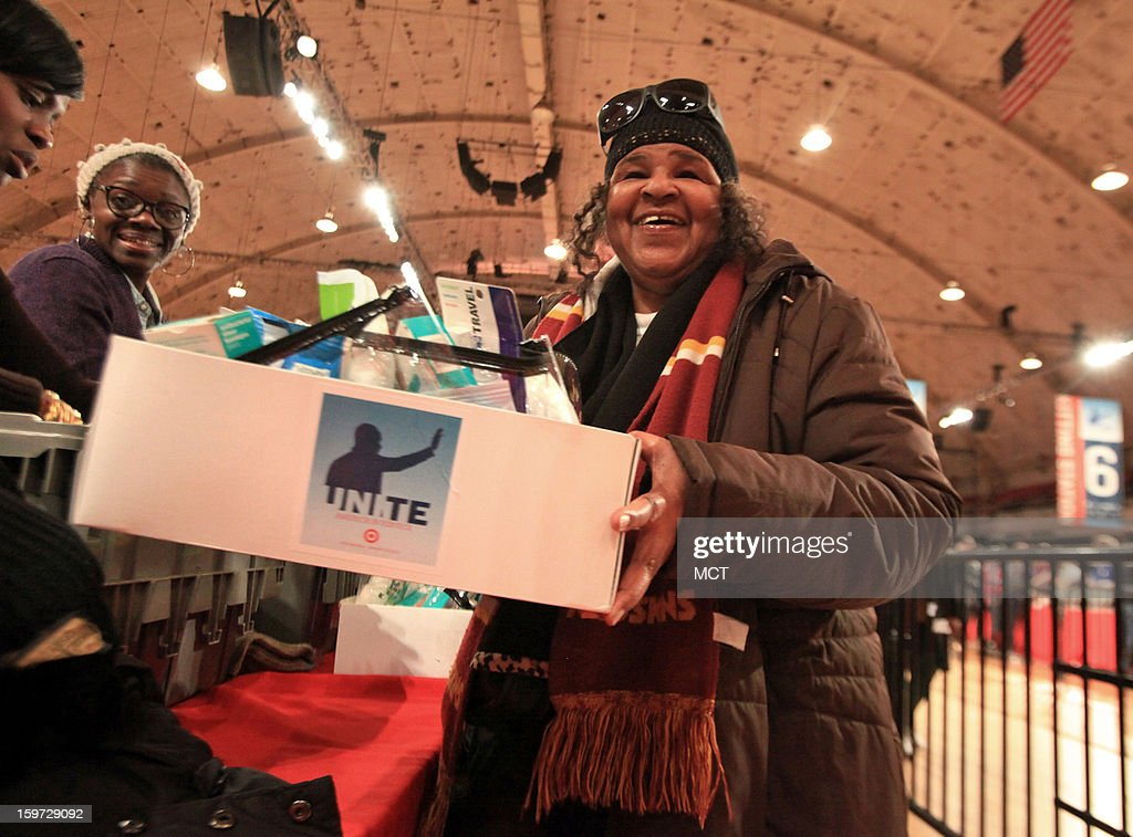 Leslie Blair, 69, of Washington, D.C. smiles after completing receives three care kits during the MLK National Day of Service at the Washington Armory in Washington, D.C, Saturday, January 19, 2013.