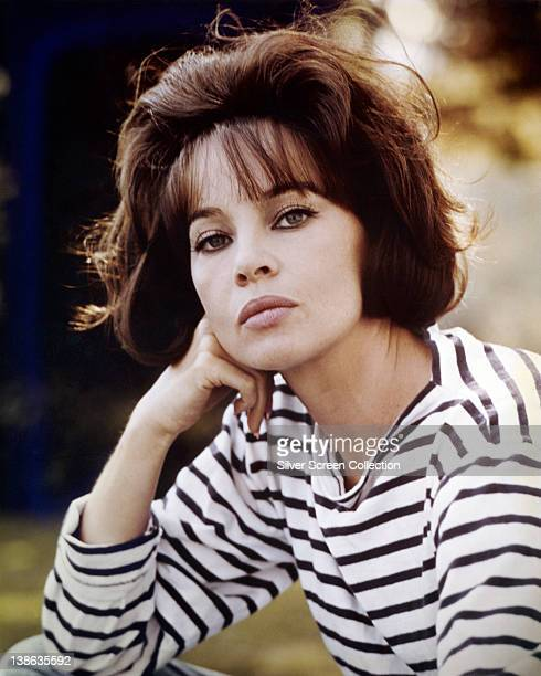 Leslie Caron French actress wearing a striped top with her chin resting on her right hand circa 1955