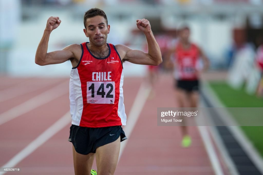Leslie Encina of Chile celebrates after winning in men's 5,000m final as part of the XVII Bolivarian Games Trujillo 2013 at Chan Chan Stadium on November 29, 2013 in Trujillo, Peru.
