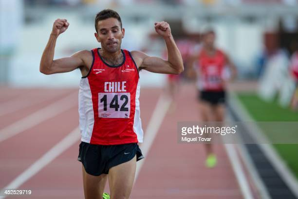 Leslie Encina of Chile celebrates after winning in men's 5000m final as part of the XVII Bolivarian Games Trujillo 2013 at Chan Chan Stadium on...