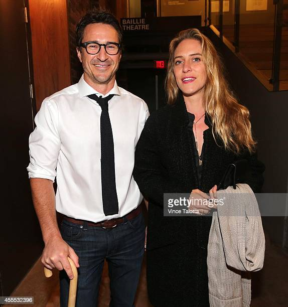 Leslie Feist and Jai Hawker pose for pictures at a David Young cocktail reception in which proceeds go to Dignitas International an organization...