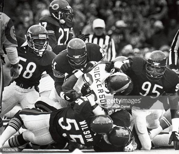 Leslie Frazier Otis Wilson and Mike Singletary of the Chicago Bears tackle Eric Dickerson of the Los Angeles Rams during the 1985 NFC Championship...