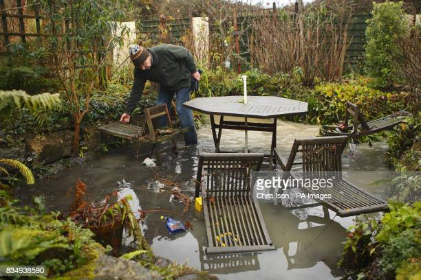 Leslie French surveys the damage to his garden in Illminster Somerset after flashflooding hit parts of the town after heavy rainfall in the South...