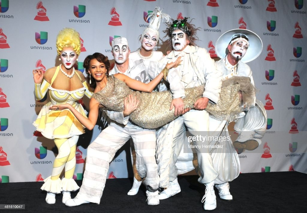 <a gi-track='captionPersonalityLinkClicked' href=/galleries/search?phrase=Leslie+Grace&family=editorial&specificpeople=9567772 ng-click='$event.stopPropagation()'>Leslie Grace</a> and Cirque Solei at the 14th Annual Latin GRAMMY Awards - Press Room on November 21, 2013 in Las Vegas, Nevada.