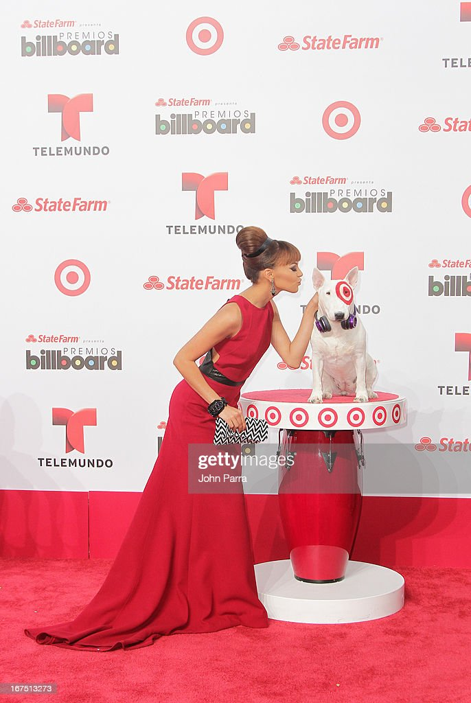 Leslie Grace celebrates with Bullseye, Target's Beloved Bull Terrier Mascot, at the 2013 Billboard Latin Music Awards at BankUnited Center on April 25, 2013 in Miami, Florida.