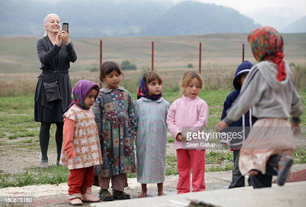 Leslie Hawke cofounder of the Romanian NGO OvidiuRo and who is also the mother of American actor Ethan Hawke takes a photo as Roma children prepare...