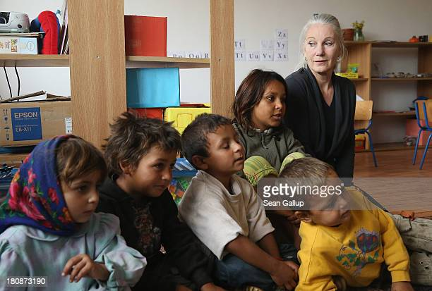 Leslie Hawke cofounder of the Romanian NGO OvidiuRo and who is also the mother of American actor Ethan Hawke looks on as Roma children attend a...