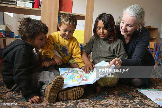 Leslie Hawke cofounder of the Romanian NGO OvidiuRo and who is also the mother of American actor Ethan Hawke shares a book with Roma children attend...