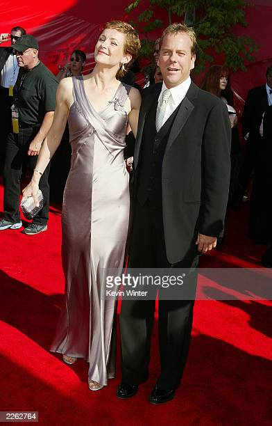 Leslie Hope and Kiefer Sutherland arrive at the 54th Annual Primetime Emmy Awards held at the Shrine Auditorium in Los Angeles CA 9/22/02 Photo by...