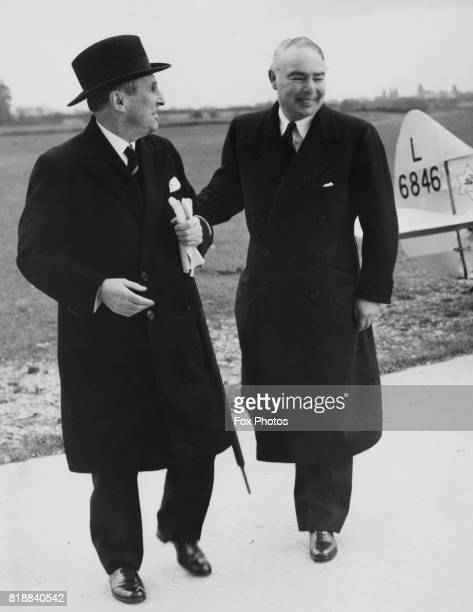 Leslie HoreBelisha the Secretary of State for War is greeted by Arthur Lee 1st Viscount Lee of Fareham at the airport as he arrives to lay the...