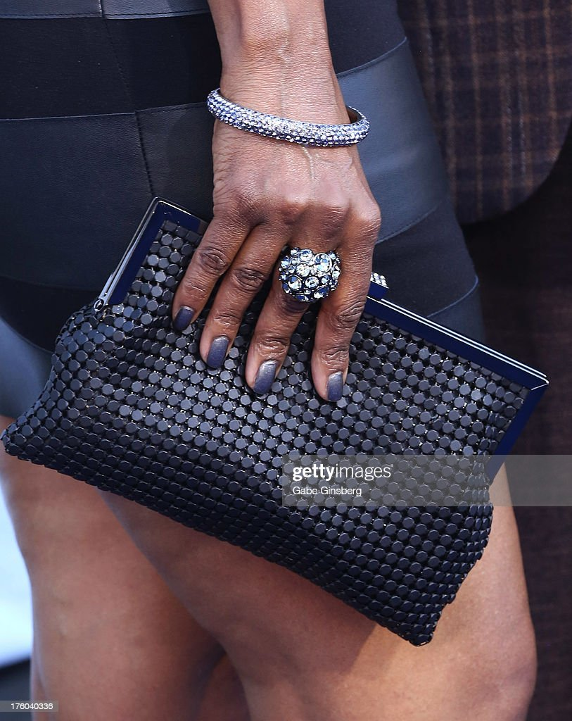 Leslie Howard (ring and purse details) arrives at the 11th annual Ford Neighborhood Awards at the MGM Grand Garden Arena on August 10, 2013 in Las Vegas, Nevada.