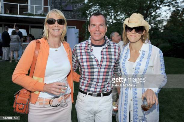 Leslie Klotz Scott Currie and Mary McBride attend GODS LOVE WE DELIVERMid Summer Night Drinks Benefit at Home of Chad A Leat on June 19 2010 in...
