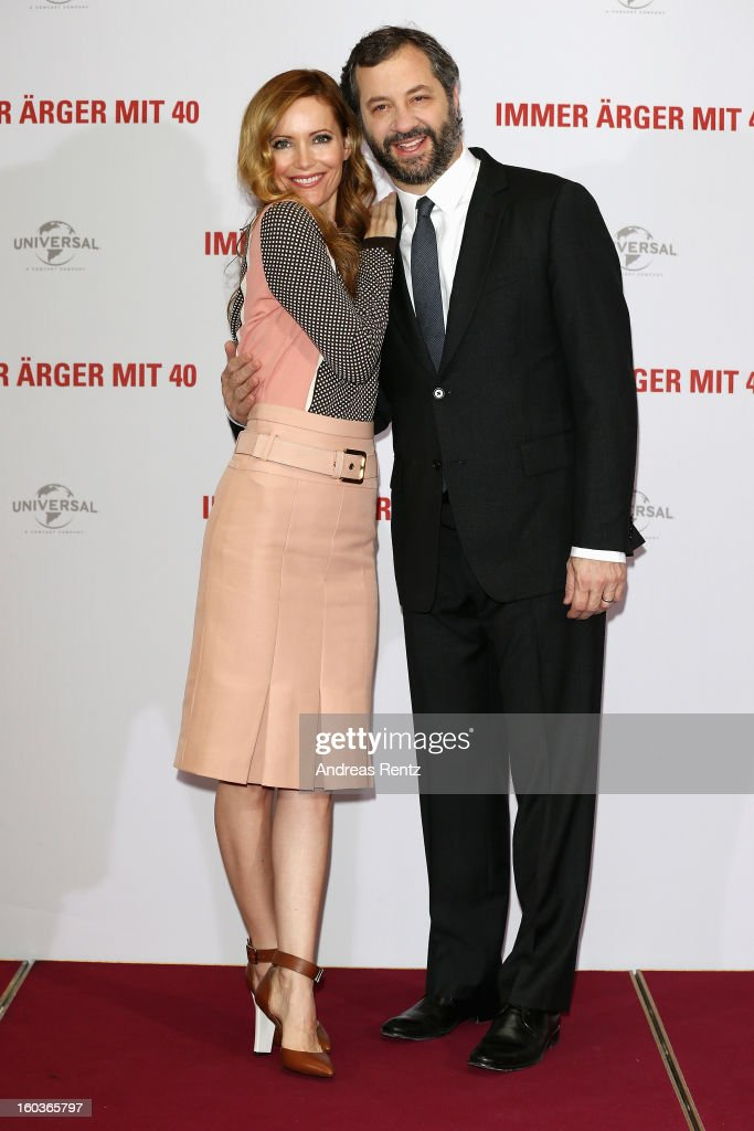 Leslie Mann and director Judd Apatow smile during the photocall 'Immer Aerger mit 40' (This Is 40) at Adlon Hotel on January 30, 2013 in Berlin, Germany.