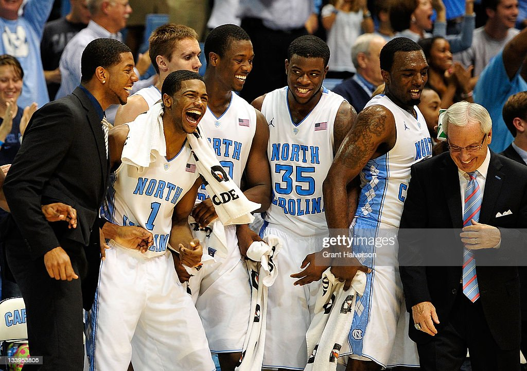 Leslie McDonald #2, Dexter Strickland #1, HArrison Barnes #40, Reggie Bullock #35, P.J. Hairston #15 and coach Roy Williams of the North Carolina Tar Heels react during the closing minute of a win over the Tenessee State Tigers at the Dean Smith Center on November 22, 2011 in Chapel Hill, North Carolina. North Carolina won 102-69.