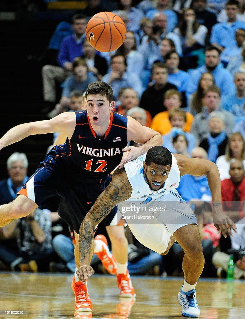 Leslie McDonald #2 of the North Carolina Tar Heels battles for a loose ball with Joe Harris #12 of the Virginia Cavaliers during play at the Dean Smith Center on February 16, 2013 in Chapel Hill, North Carolina. North Carolina won 93-81.