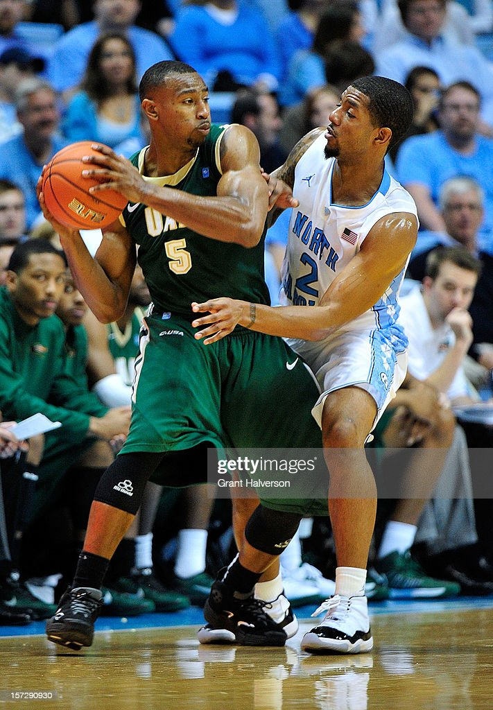 Leslie McDonald #2 of the North Carolina Tar Heels defends Robert Williams #5 of the UAB Blazers during play at the Dean Smith Center on December 1, 2012 in Chapel Hill, North Carolina. North Carolina won 102-84.