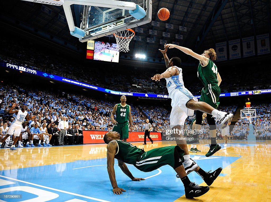 Leslie McDonald #2 of the North Carolina Tar Heels draws a charging foul as he knocks Robert Williams #5 of the UAB Blazers to the floor during play at the Dean Smith Center on December 1, 2012 in Chapel Hill, North Carolina. North Carolina won 102-84.