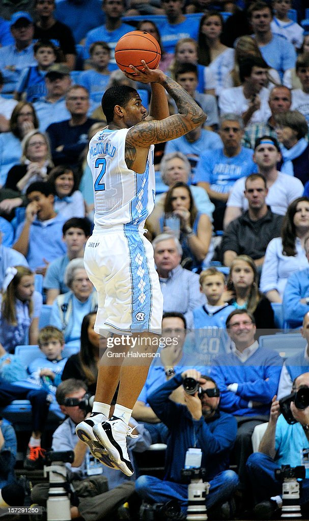 Leslie McDonald #2 of the North Carolina Tar Heels launches a 3-point hot against the UAB Blazers during play at the Dean Smith Center on December 1, 2012 in Chapel Hill, North Carolina.