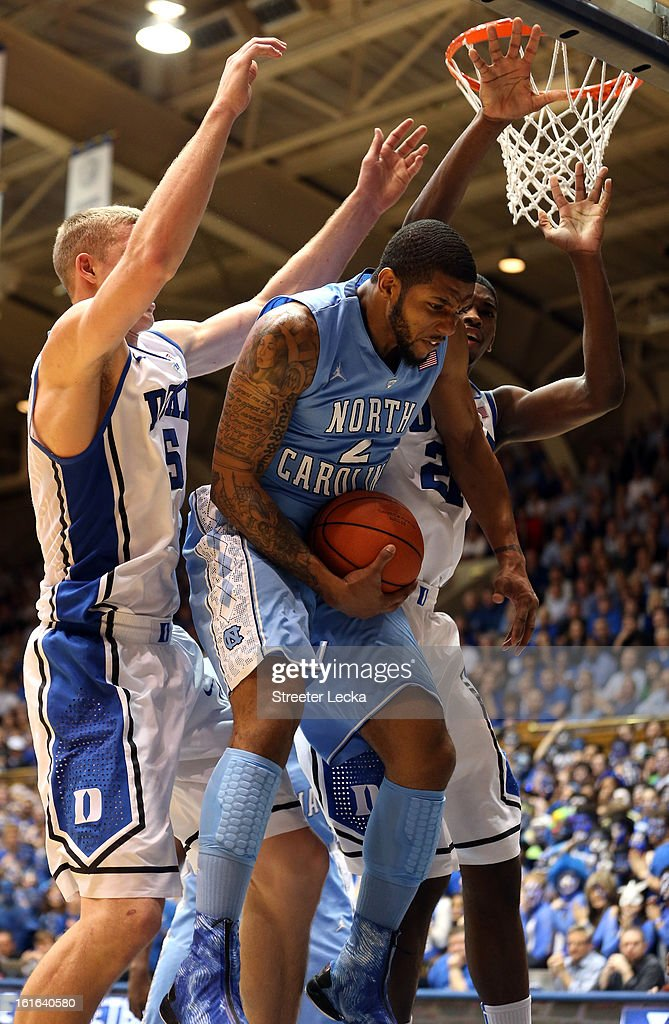 Leslie McDonald #2 of the North Carolina Tar Heels rebounds the ball over Mason Plumlee #5 of the Duke Blue Devils and teammate Amile Jefferson #21 during their game at Cameron Indoor Stadium on February 13, 2013 in Durham, North Carolina.