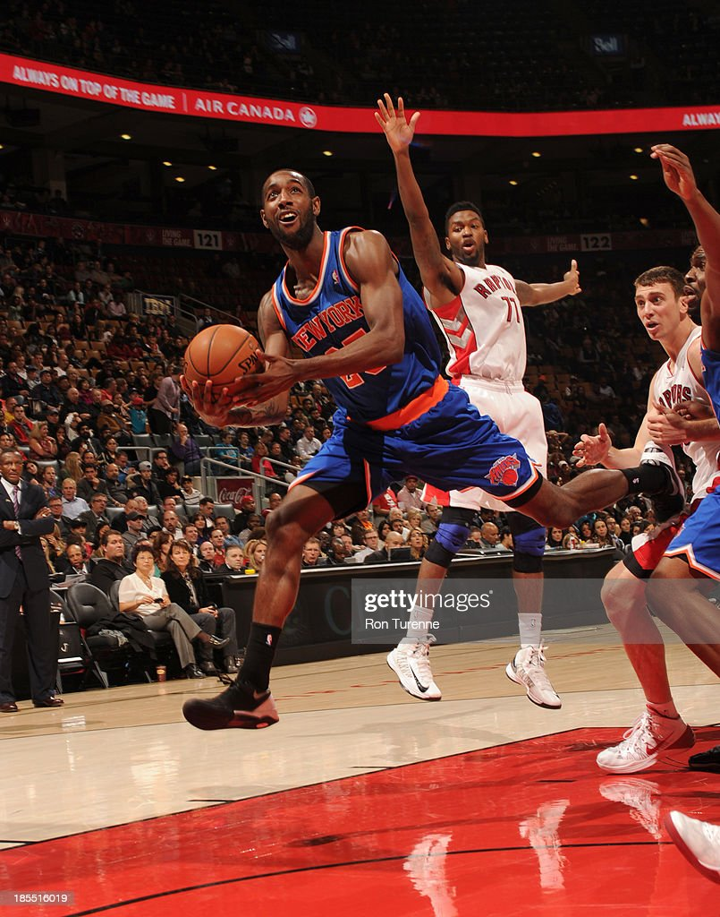 CJ Leslie #25 of the New York Knicks puts up the shot against the Toronto Raptors during the game on October 21, 2013 at the Air Canada Centre in Toronto, Ontario, Canada.