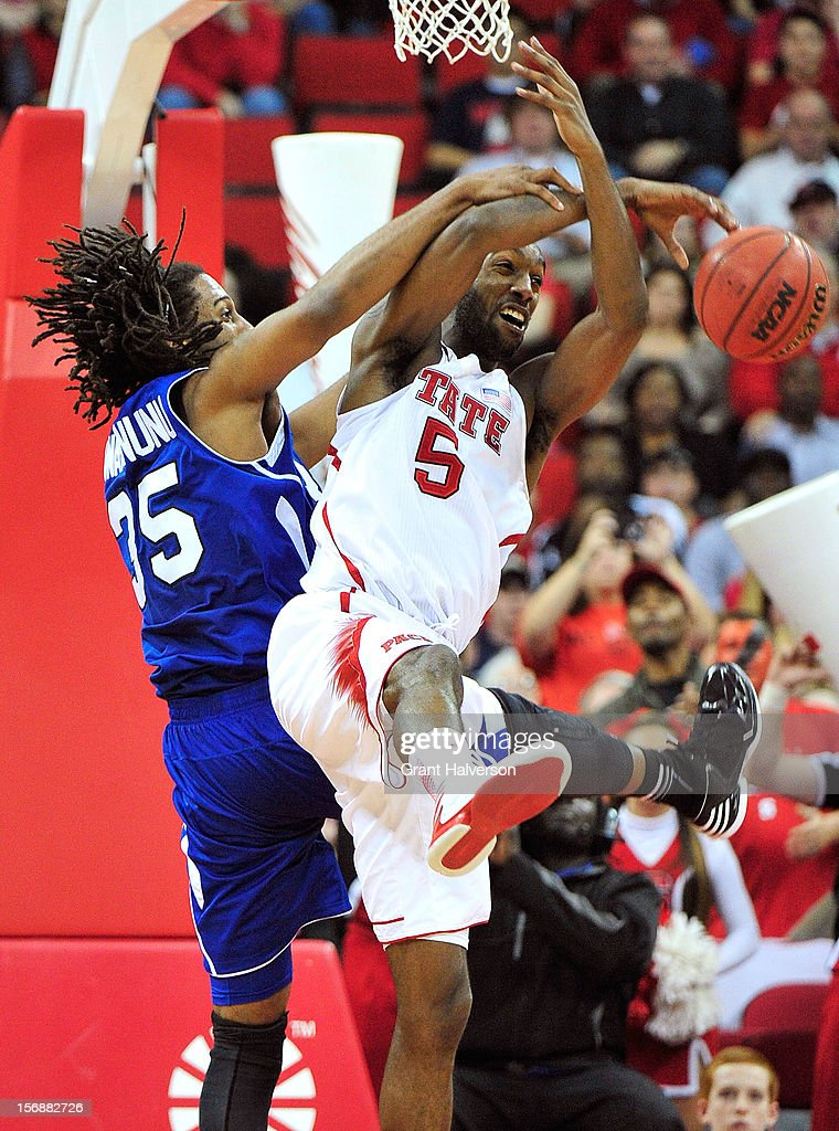 C.J. Leslie #5 of the North Carolina State Wolfpack battles for a rebound with Jon Nwannunu #35 of the North Carolina-Asheville Bulldogs during play at PNC Arena on November 23, 2012 in Raleigh, North Carolina. North Carolina State won 82-80.