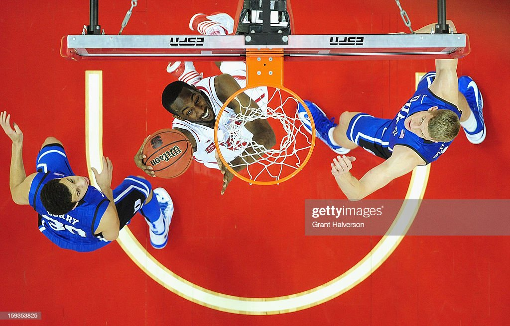 C.J. Leslie #5 of the North Carolina State Wolfpack dunks over Seth Curry #30 and Mason Plumlee #5 of the Duke Blue Devils during play at PNC Arena on January 12, 2013 in Raleigh, North Carolina. North Carolina State won 84-76.