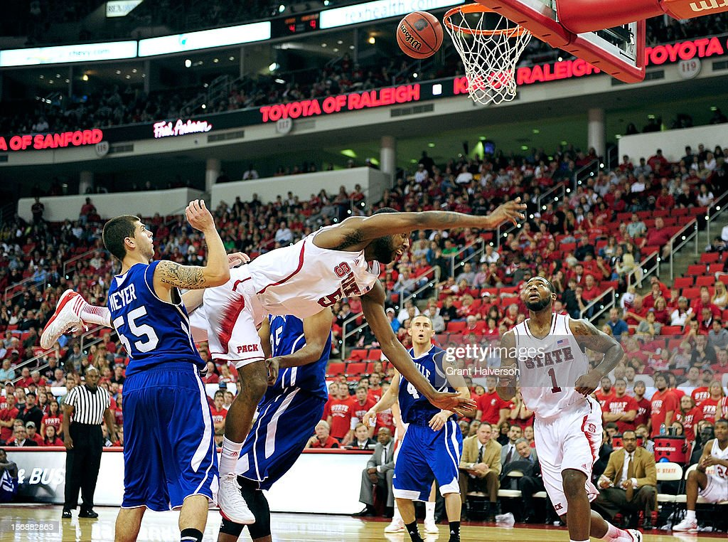 C.J. Leslie #5 of the North Carolina State Wolfpack loses control on a drive to the basket as he is fouled by Jon Nwannunu #35 of the North Carolina-Asheville Bulldogs during play at PNC Arena on November 23, 2012 in Raleigh, North Carolina. North Carolina State won 82-80.