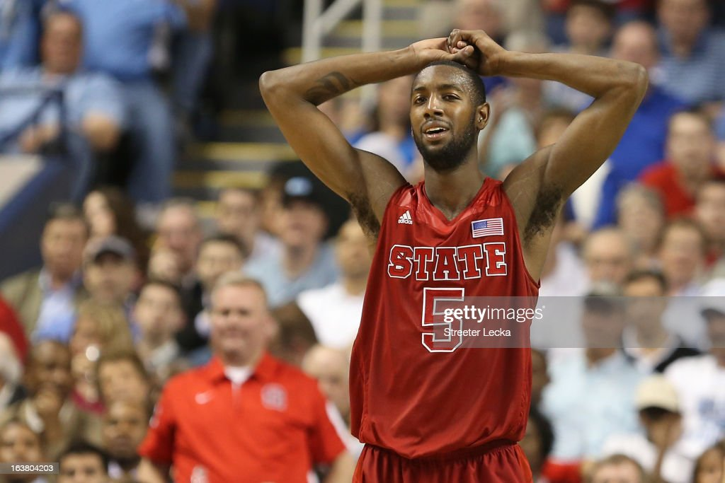 C.J. Leslie #5 of the North Carolina State Wolfpack reacts after called for goaltending in the second half while taking on the Miami Hurricanes during the men's ACC Tournament semifinals at Greensboro Coliseum on March 16, 2013 in Greensboro, North Carolina.