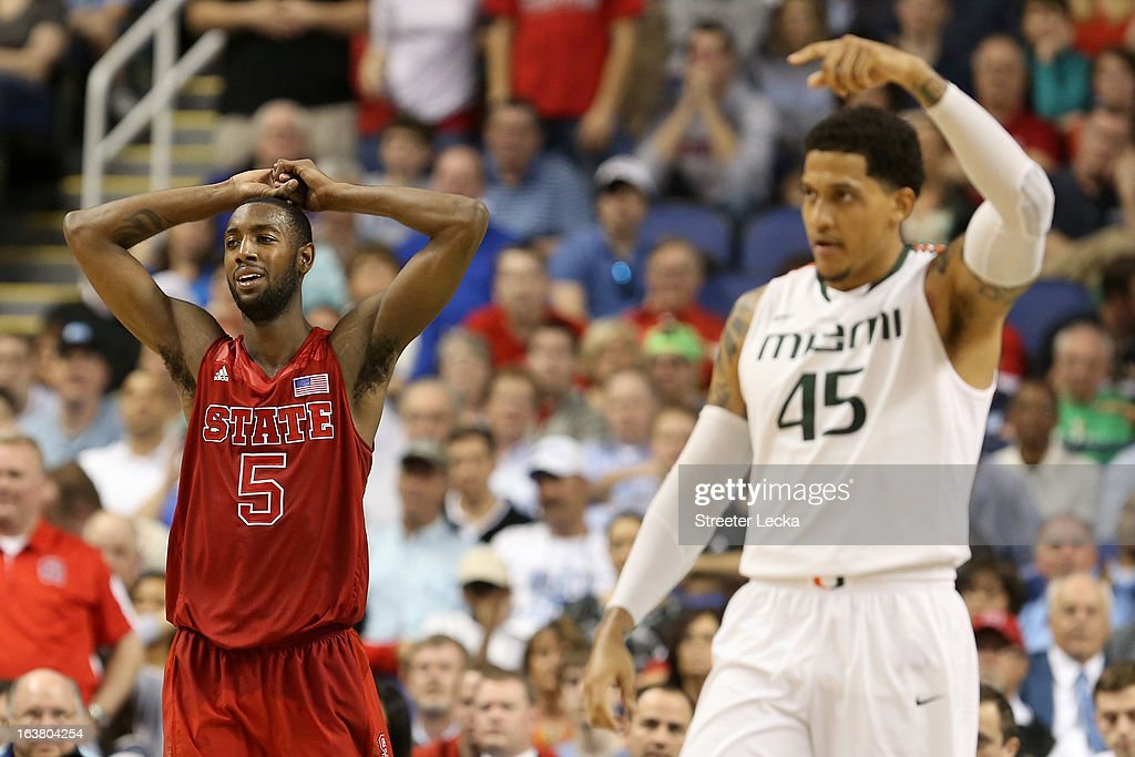 C.J. Leslie #5 of the North Carolina State Wolfpack reacts after called for goaltending in the second half while as Julian Gamble #45 of the Miami Hurricanes reacts during the men's ACC Tournament semifinals at Greensboro Coliseum on March 16, 2013 in Greensboro, North Carolina.