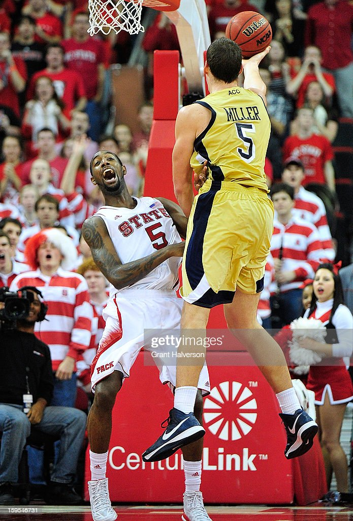 C.J. Leslie #5 of the North Carolina State Wolfpack reacts as he collides with Daniel Miller #5 of the Georgia Tech Yellow Jackets during play at PNC Arena on January 9, 2013 in Raleigh, North Carolina. North Carolina State won 83-70.