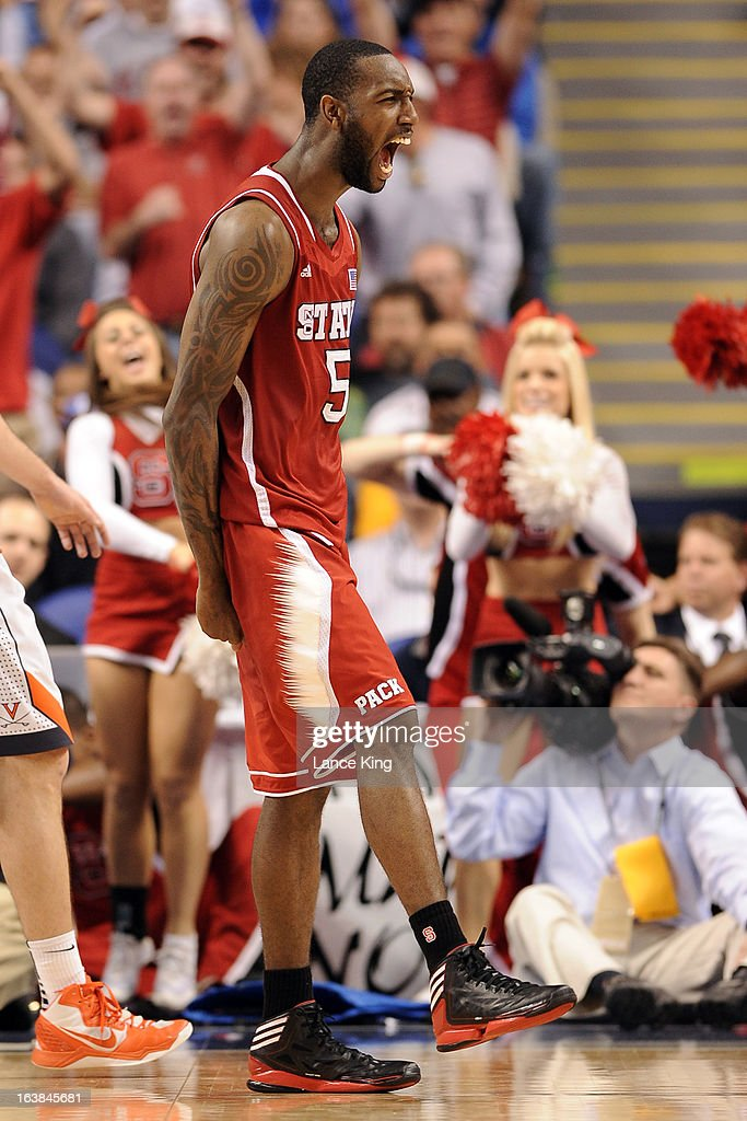 C.J. Leslie #5 of the North Carolina State Wolfpack reacts following a play against the Virginia Cavaliers during the quarterfinals of the 2013 Men's ACC Tournament at the Greensboro Coliseum on March 15, 2013 in Greensboro, North Carolina. NC State defeated Virginia 75-56.