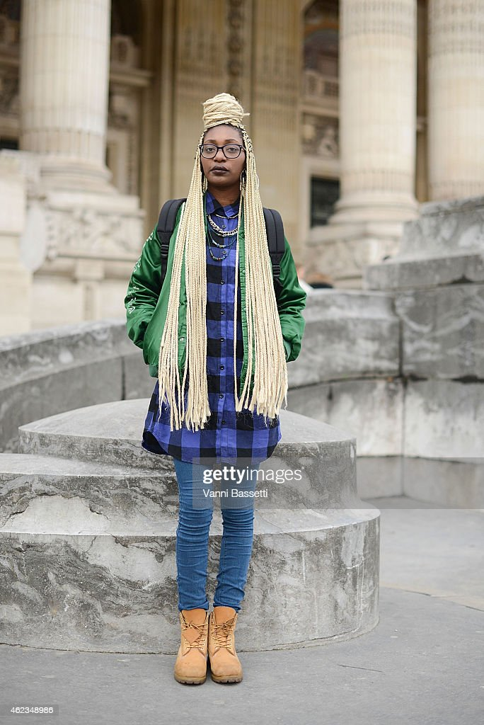 Leslie Okombi poses wearing a vintage outfit during day 3 of Paris Haute Couture Spring Summer 2015 on January 27, 2015 in Paris, France.