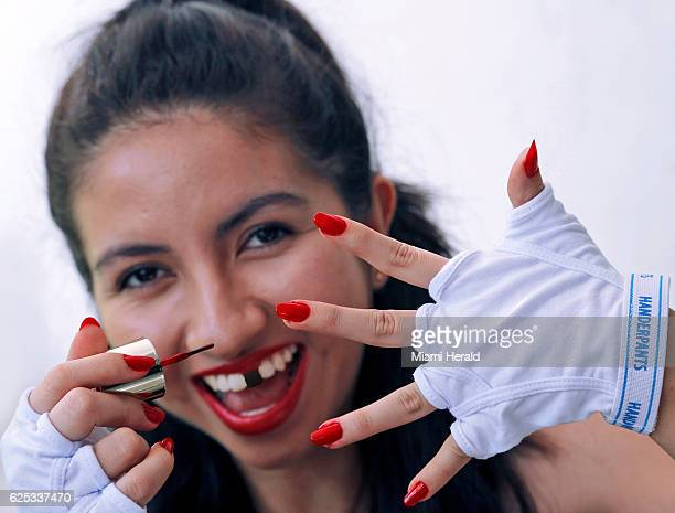 Leslie Ovalle center highlights her polished nails thanks to Handerpants