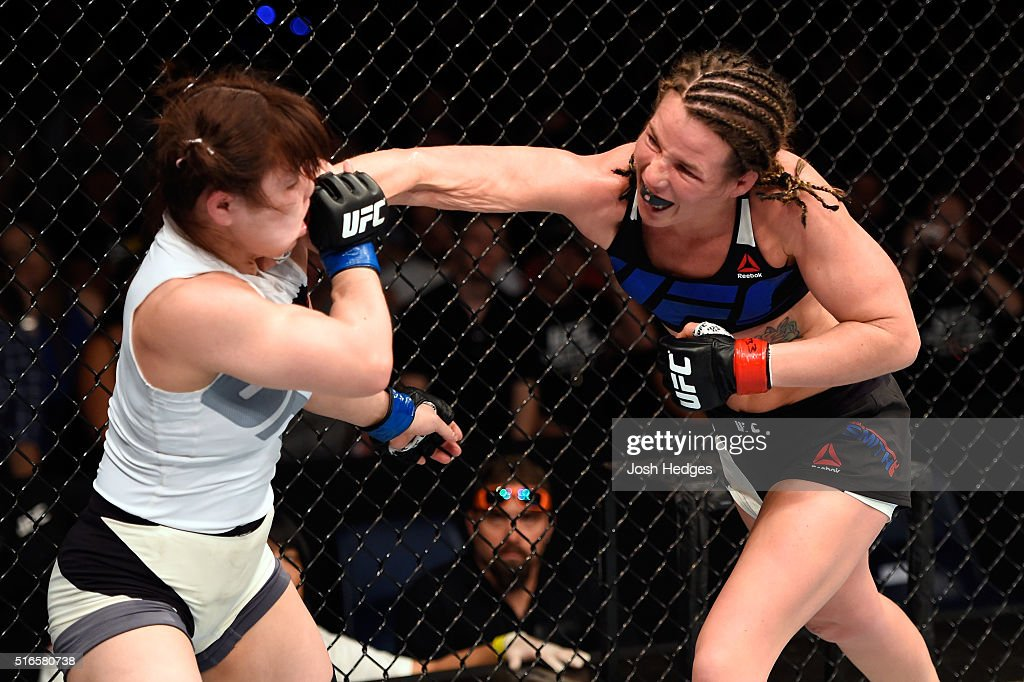 Leslie Smith of the United States punches Rin Nakai of Japan in their women's bantamweight bout during the UFC Fight Night event at the Brisbane Entertainment Centre on March 20, 2016 in Brisbane, Australia.