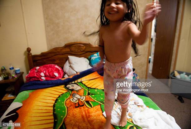Lesly Macias jumps on the bed as her mother tried to put her pajamas on Last year Alabama passed the harshest law against illegal immigrants in the...