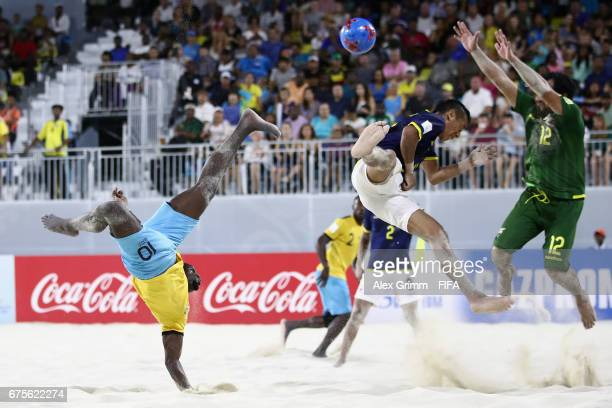 Lesly St Fleur of Bahamas attempts a bicycle kick next to Jorge Bailon and goalkeeper Jorge Leon of Ecuador during the FIFA Beach Soccer World Cup...