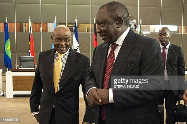Lesotho Prime Minister Thomas Thabane and South African Deputy President Cyril Ramaphosa talk at the end of a Southern Africa Development Community...
