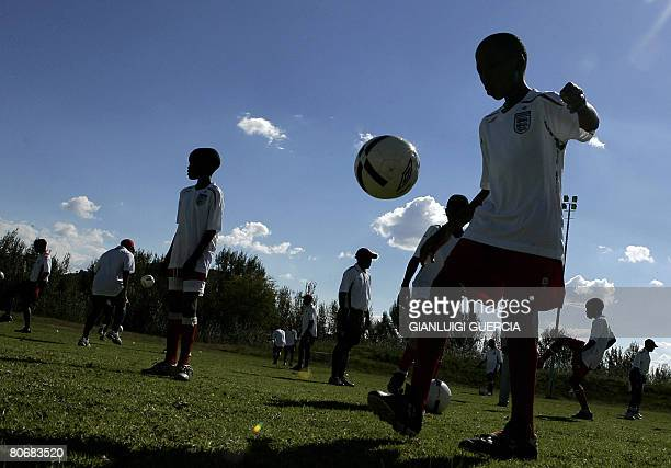 Lesotho school children practice on April 15 2008 during a football training session attended by unseen England football team head coach Italian born...