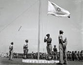 Less than 3 weeks before Israel's independence the flag of the future Jewish State is raised at morning parade at a training base of the fledgling...